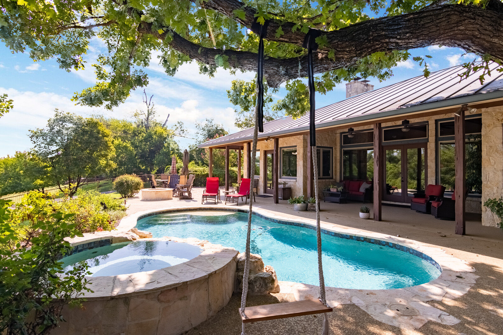 photo of pool and spa area of West Evergreen Retreat, Boerne, Texas