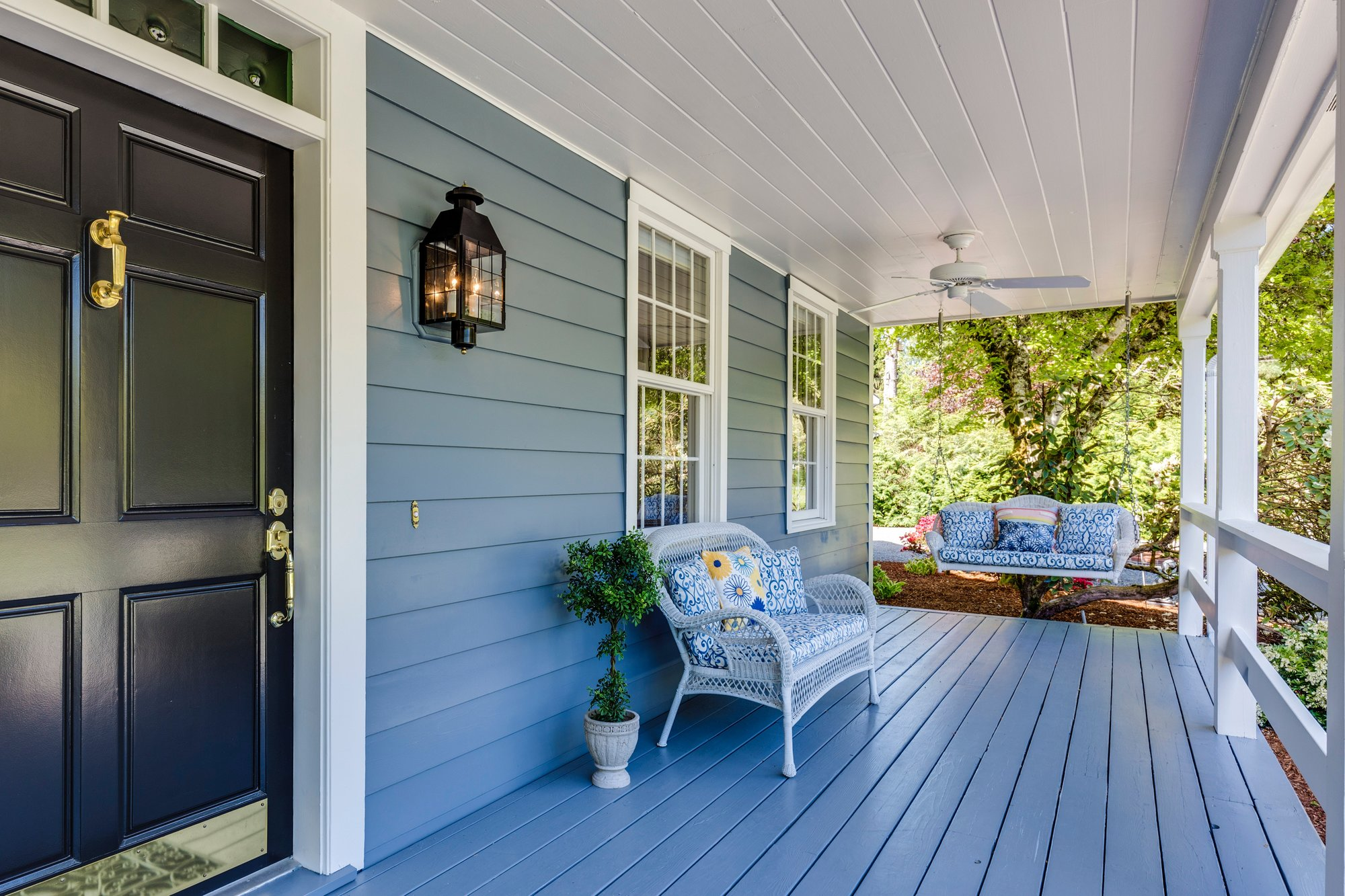front porch painted blue with white trim