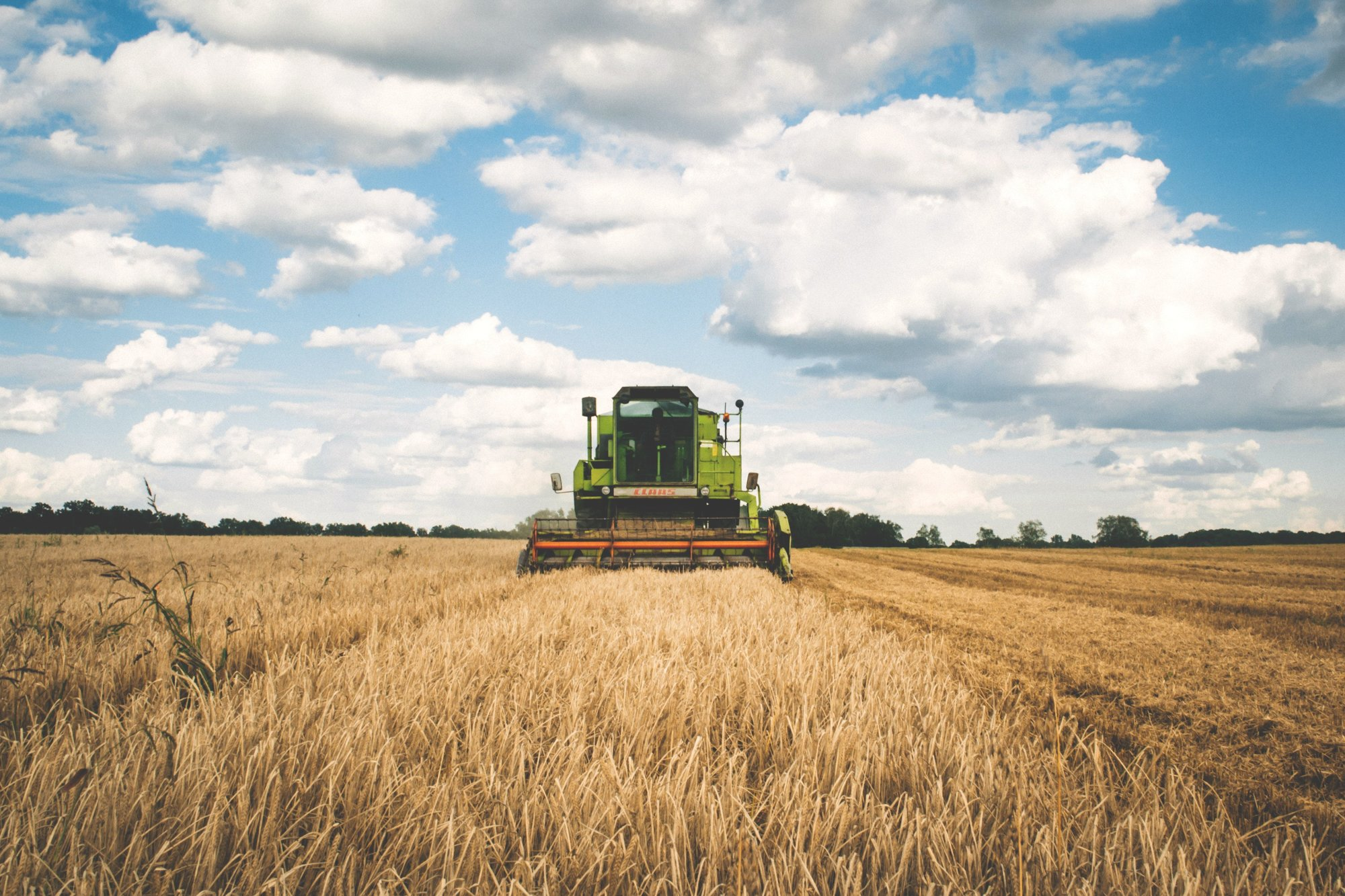green-tractor-wheat-field-farming-2020